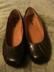 Black leather flats by Clarks