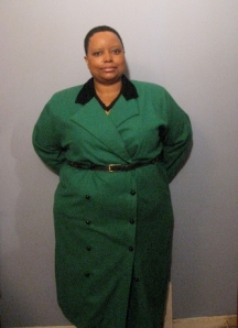 A front view of The Wicked Woman in her green funeral ensemble