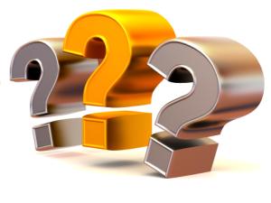 three metalic question marks
